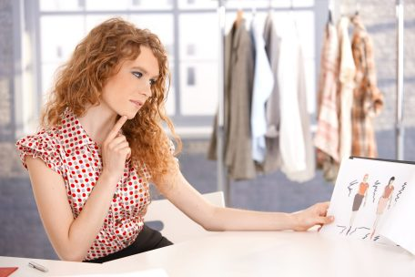 8083471 - young attractive fashion designer working in office at desk thinking.
